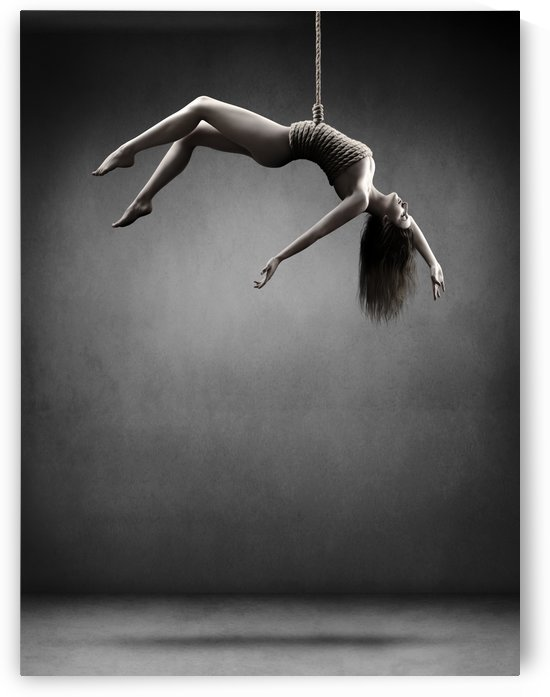 Woman hanging on a rope by Johan Swanepoel