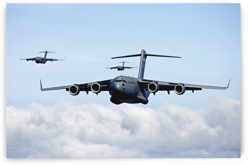 U.S. Air Force C-17 Globemasters in flight. by StocktrekImages