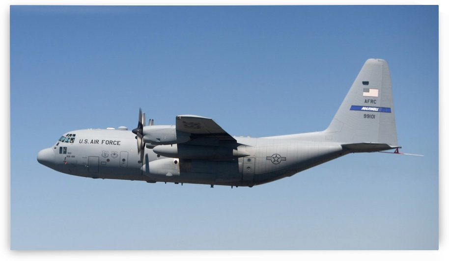 A specially modified C-130 Hercules in flight. by StocktrekImages