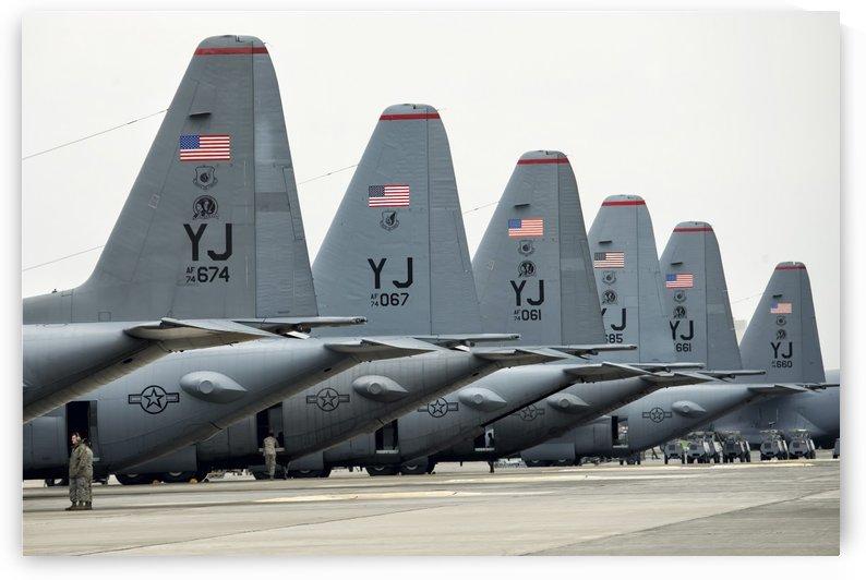 U.S. Air Force C-130 Hercules aircraft on the flight line at Yokota Air Base. by StocktrekImages
