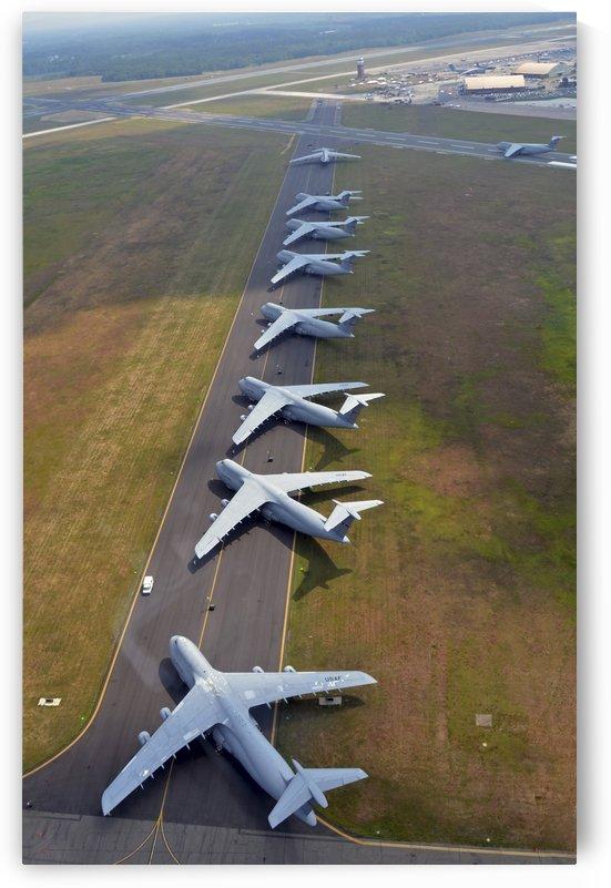 C-5 Galaxies align on the runway. by StocktrekImages