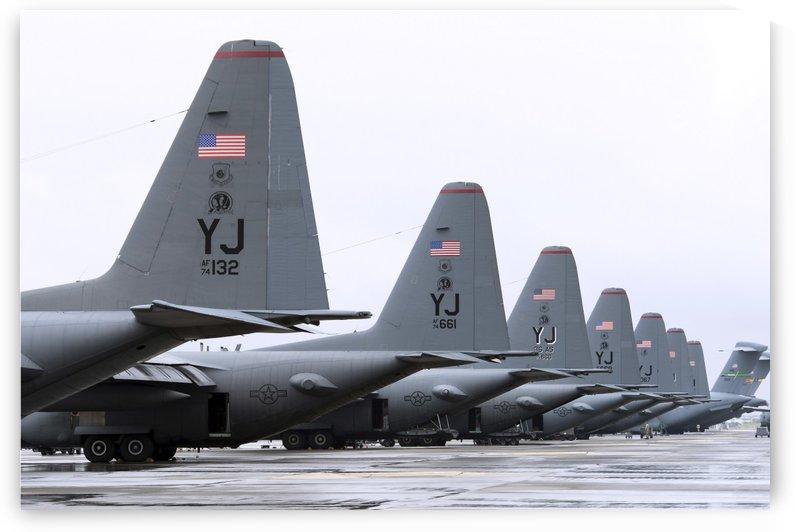 C-130 Hercules on the flightline at Yokota Air Base Japan. by StocktrekImages