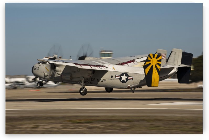 A C-2 Greyhound lands on Naval Air Station North Island. by StocktrekImages