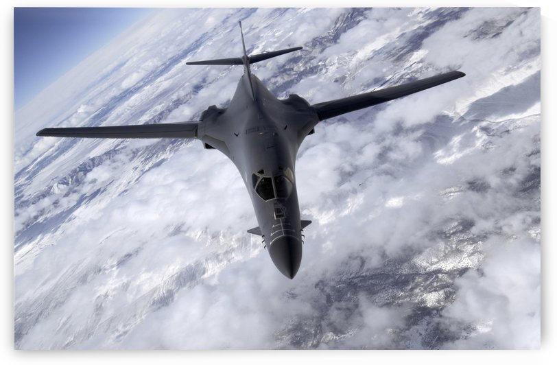 A B-1B Lancer flies over the Nevada and Utah region. by StocktrekImages