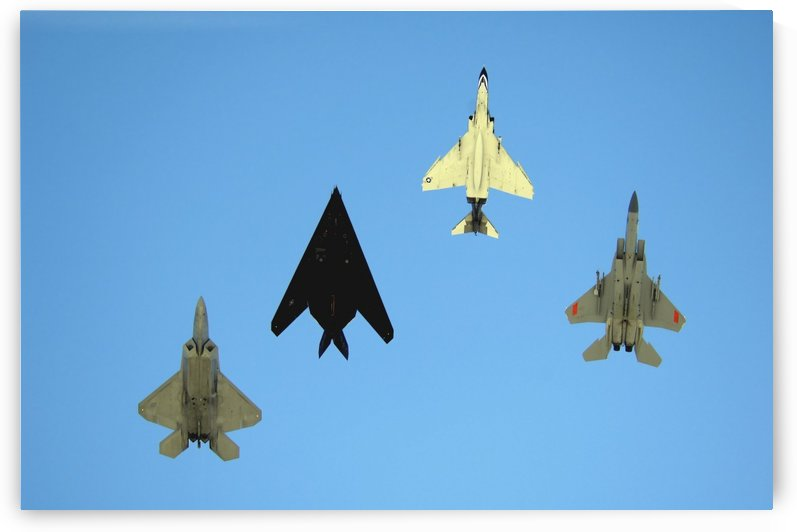 An F-22 Raptor an F-117 Nighthawk an F-4 Phantom and an F-15 Eagle in flight. by StocktrekImages