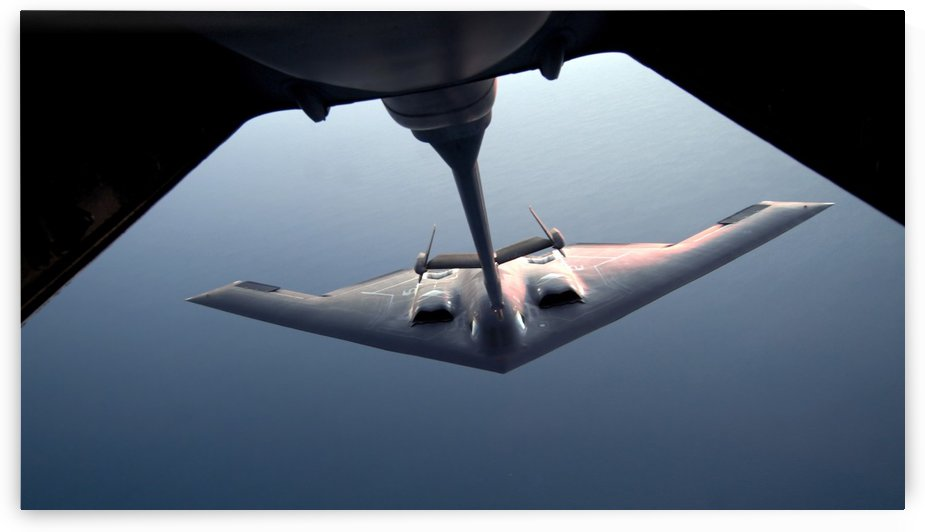 A B-2 Spirit bomber conducts a refueling with a KC-10 Extender. by StocktrekImages