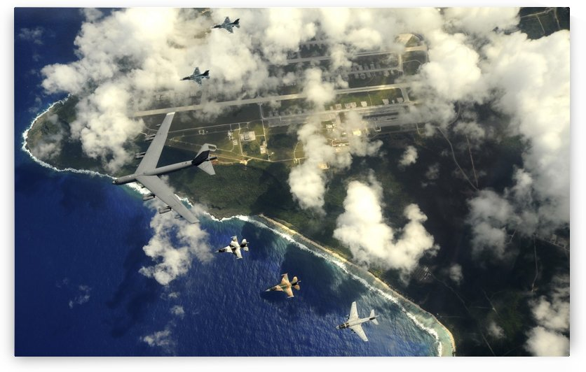 A B-52 Stratofortress leads a formation of aircraft over Guam. by StocktrekImages