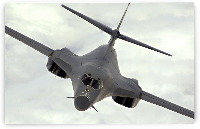 A B-1B Lancer streaks through the sky. by StocktrekImages