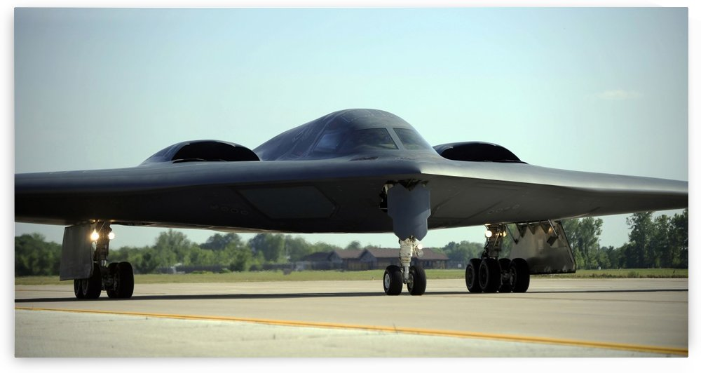 A B-2 Spirit taxis onto the flightline at Whiteman Air Force Base Missouri. by StocktrekImages