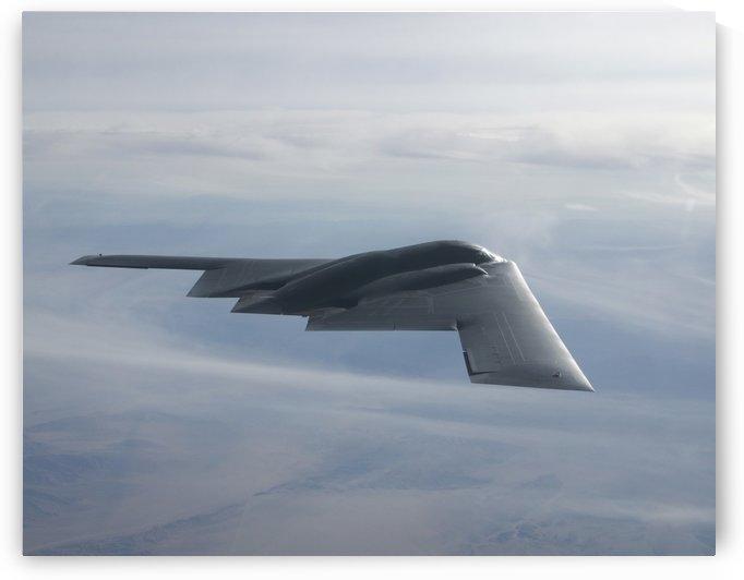 A B-2 Spirit soars through the sky. by StocktrekImages