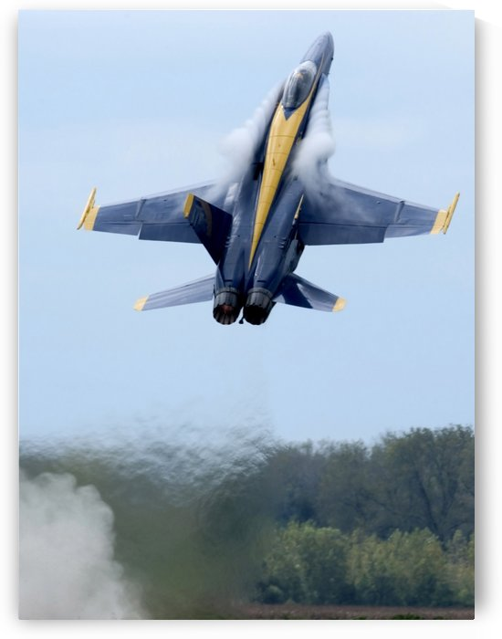 Lead solo pilot of the Blue Angels performs a high performance climb. by StocktrekImages