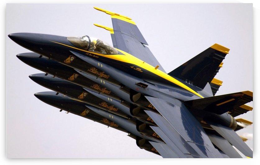 Four Blue Angels F-A-18C Hornets perform the Echelon Parade maneuver by StocktrekImages