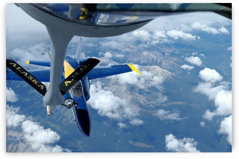 A KC-135 Stratotanker refuels an F-A-18 Hornet. by StocktrekImages