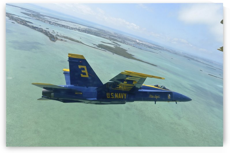 An F-A-18 Hornet of the Blue Angels flies over the Florida Keys. by StocktrekImages