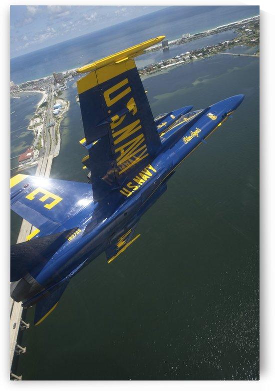 An F-A-18 Hornet of the Blue Angels over Pensacola Beach Florida. by StocktrekImages
