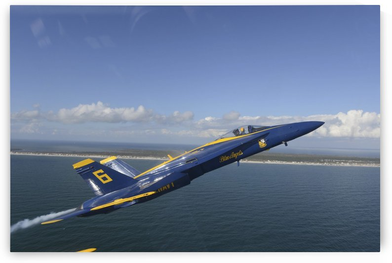 An F-A-18 Hornet from the Blue Angels during a training flight. by StocktrekImages