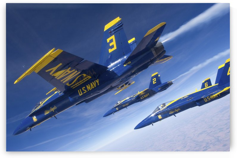 F-A-18 Hornets of the Blue Angels fly in formation over Colorado. by StocktrekImages