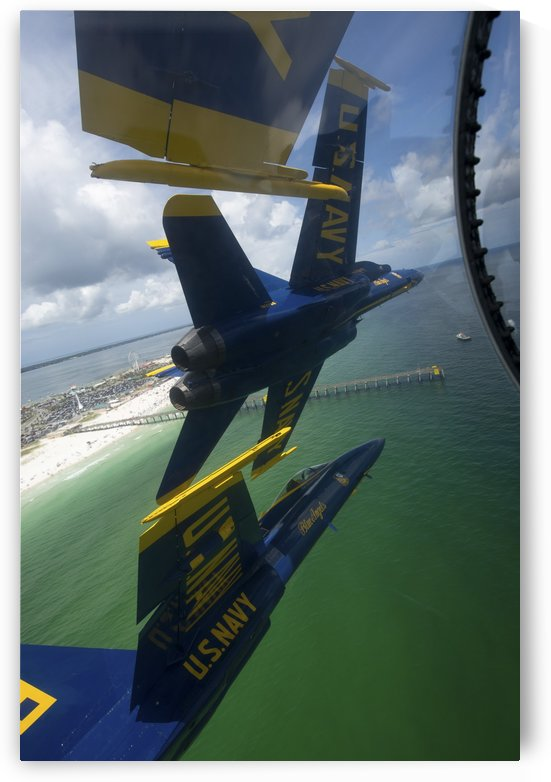 The Blue Angels perform the Diamond 360 maneuver over Florida. by StocktrekImages