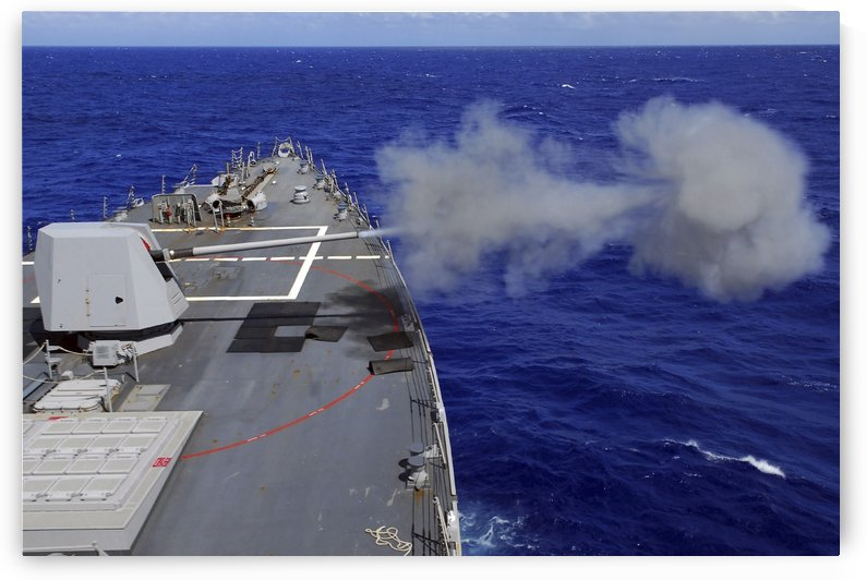The guided-missile destroyer USS McCampbell fires the MK-45 gun system. by StocktrekImages