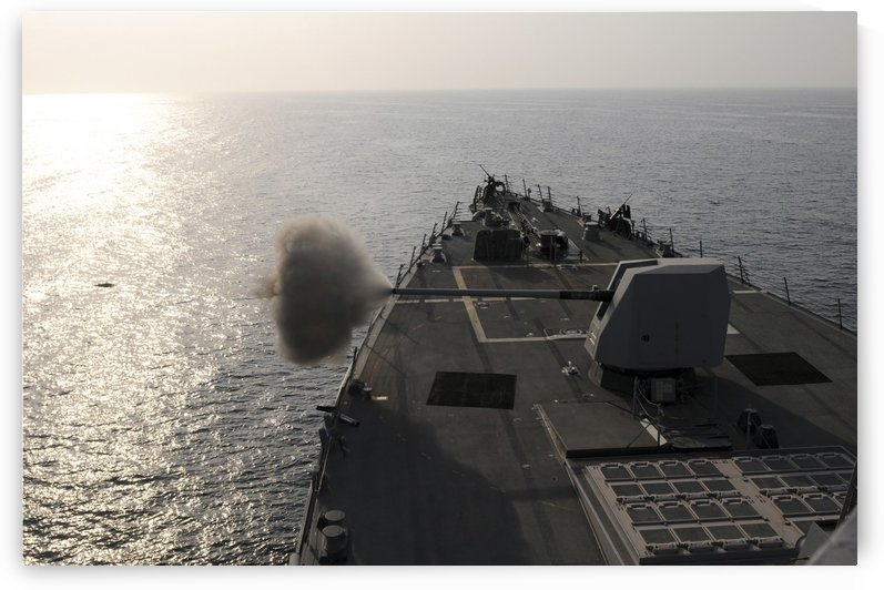 An Mk-45 lightweight gun is fired aboard guided missile destroyer USS Truxtun. by StocktrekImages