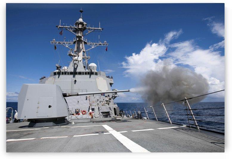 Guided-missile destroyer USS Pinckney fires its MK-45 5-inch-54-caliber gun. by StocktrekImages