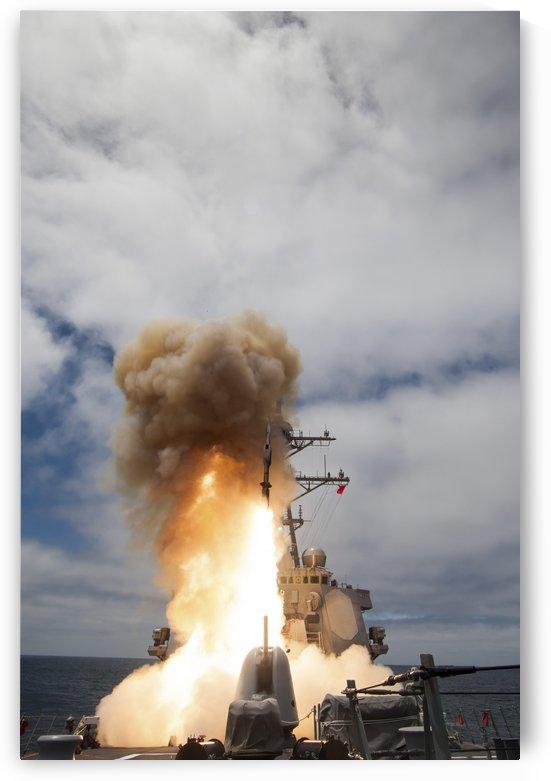 USS John Paul Jones launches a Standard Missile. by StocktrekImages