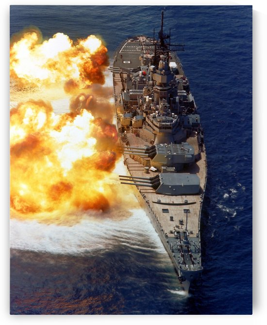 Battleship USS Iowa firing its Mark 7 16-inch-50-caliber guns. by StocktrekImages
