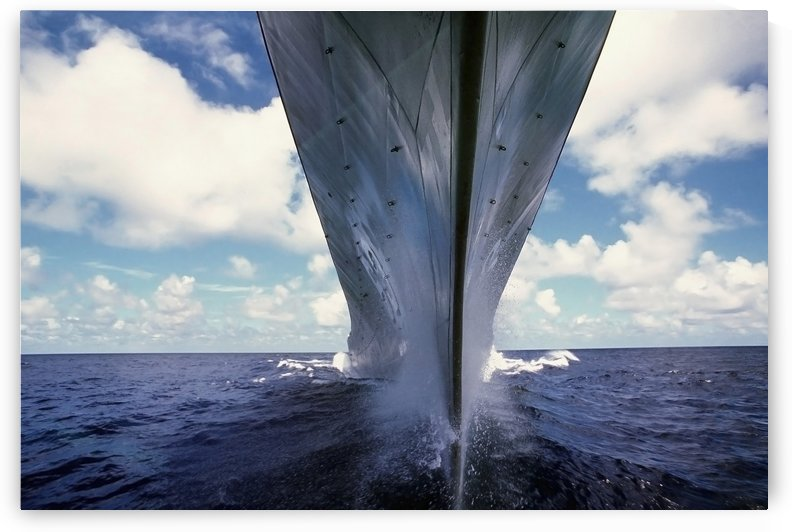 A water-level bow view of the battleship USS Missouri. by StocktrekImages