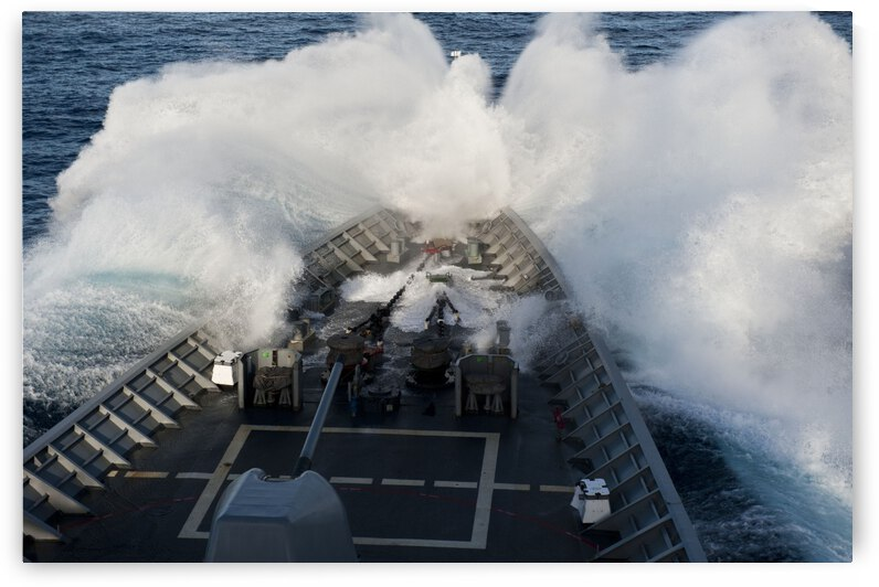 The bow of USS Cowpens plows through a wave in rough seas. by StocktrekImages