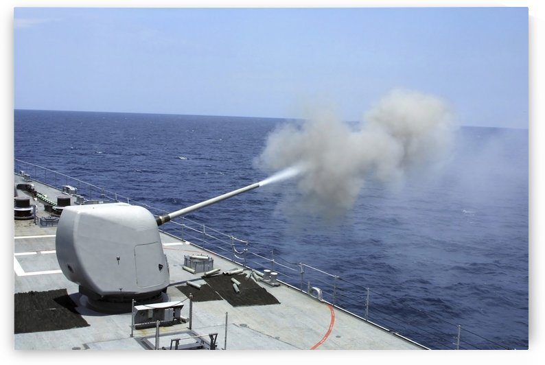 The guided missile destroyer USS Spruance fires its 5 54 gun. by StocktrekImages
