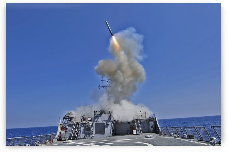 USS Barry launches a Tomahawk cruise missile. by StocktrekImages