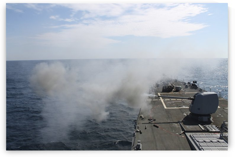The Mark 45 lightweight gun is fired aboard USS Mahan. by StocktrekImages