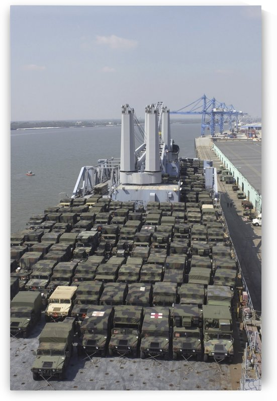 U.S. Army Humvees are loaded onto USNS Pililau. by StocktrekImages