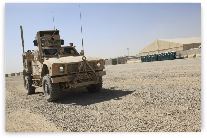 An Oshkosh M-ATV sits parked at Camp Leatherneck Afghanistan. by StocktrekImages