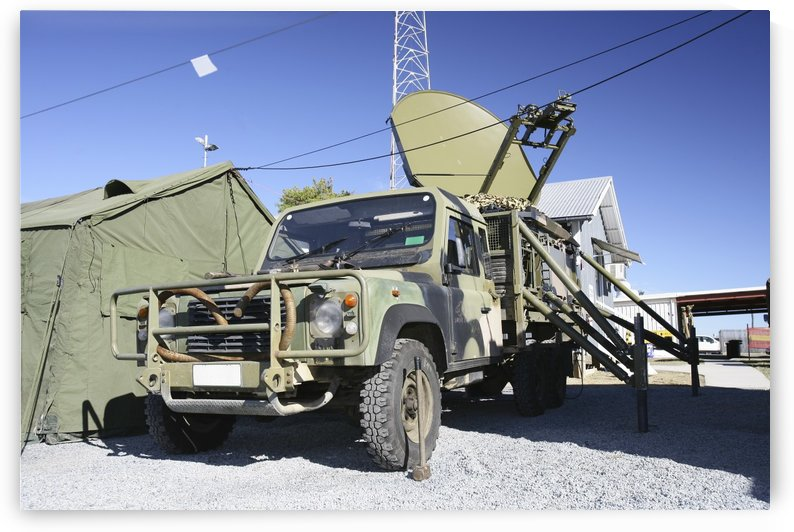 An Australian Defense Force Satellite Terminal Assembly is mounted on a 6x6 vehicle . by StocktrekImages