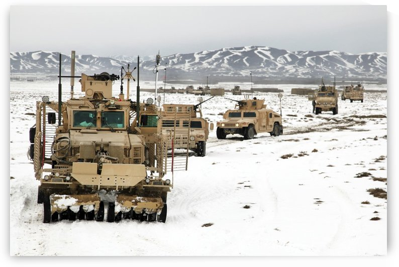 A convoy of vehicles during a route clearing procedure in Afghanistan. by StocktrekImages