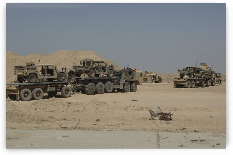 HEMTT trucks carry combat modified versions of M998 humvees. by StocktrekImages