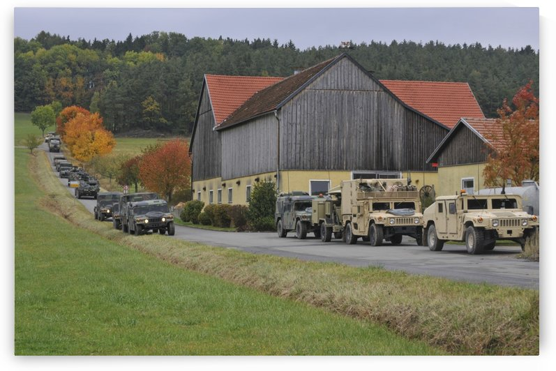Convoy of U.S. Army vehicles in Amberg Germany. by StocktrekImages