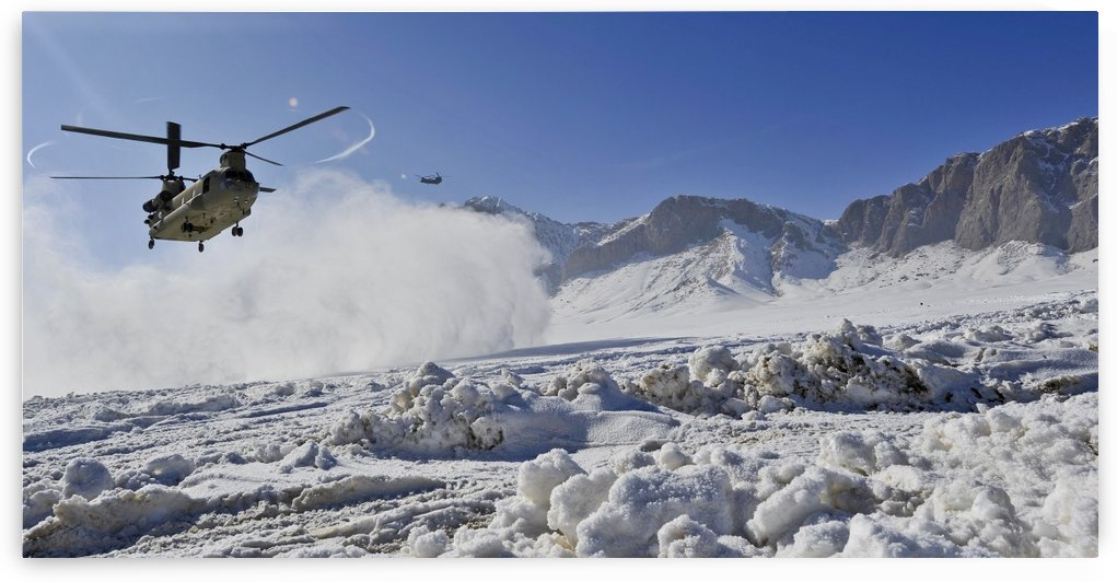 Snow flies up as a U.S. Army CH-47 Chinook prepares to land. by StocktrekImages