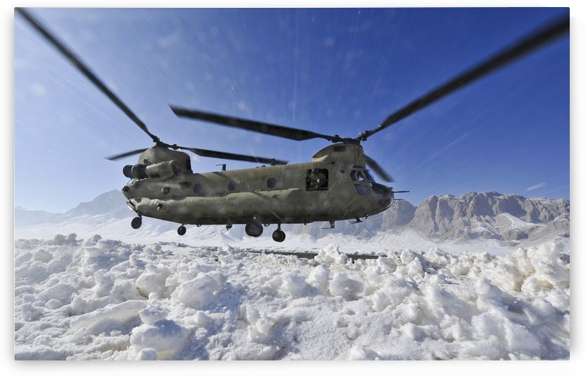 Snow flies up as a U.S. Army CH-47 Chinook helicopter prepares to land. by StocktrekImages