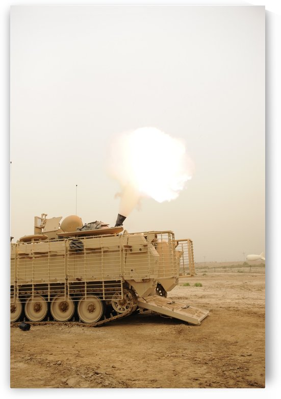 A M120 Mortar system is fired out of a M113 Armored Personal Carrier. by StocktrekImages