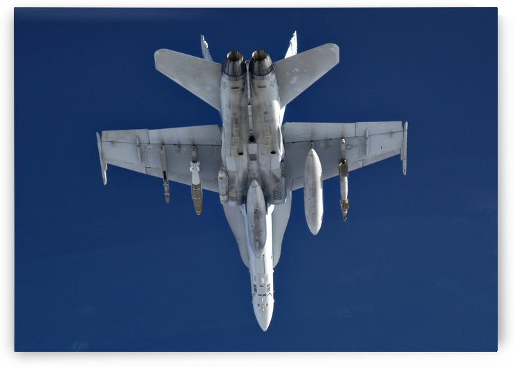 An F-A-18 Hornet on patrol. by StocktrekImages