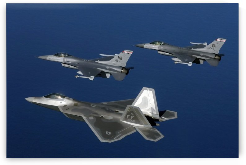 Three F-22A Raptor aircrafts fly in formation. by StocktrekImages