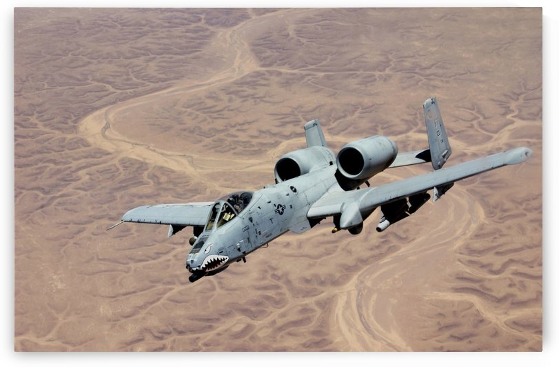 An A-10 Thunderbolt soars above the skies of Iraq. by StocktrekImages
