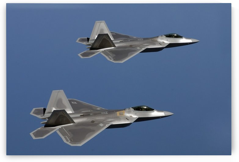 F-22A Raptors fly over Langley Air Force Base Virginia. by StocktrekImages