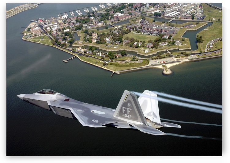 A F-A 22 Raptor flies over Fort Monroe. by StocktrekImages
