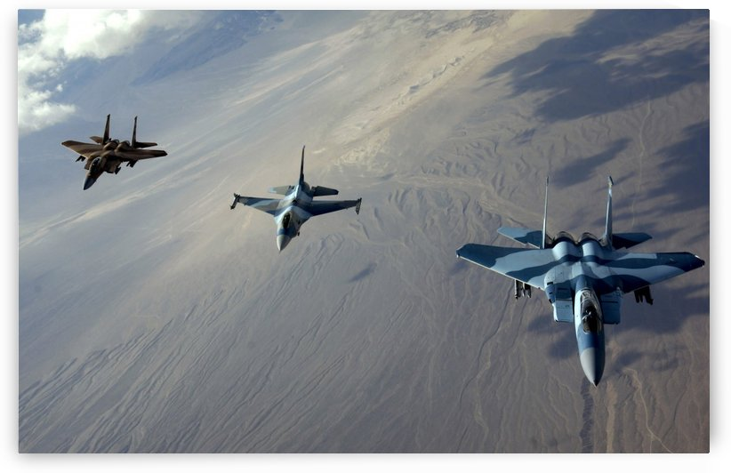 F-15 Eagles and a F-16 Fighting Falcon fly in formation. by StocktrekImages