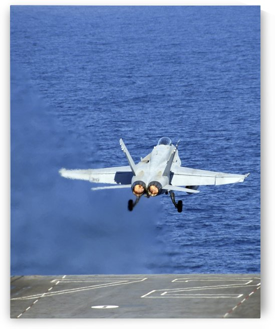 An F-A-18C Hornet launches from the USS Abraham Lincoln. by StocktrekImages