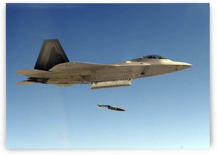 An F-22A Raptor drops a GBU-32 bomb. by StocktrekImages