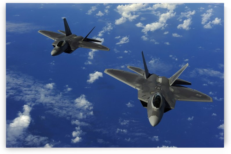 U.S. Air Force F-22 Raptors in flight near Guam. by StocktrekImages